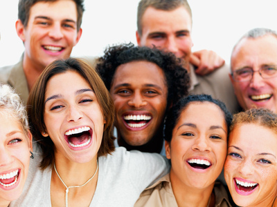 closeup portrait of a group of business people laughing © Richard foster - flickr.com