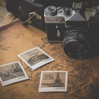 Camera and photographs on an old map geodata